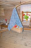 The hanging cradle in historic peasant house, Suzdal Royalty Free Stock Images