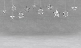 Hanging crystal balls and stars ornaments on concrete background. For new year or christmas theme. 3D rendering. Stock Image