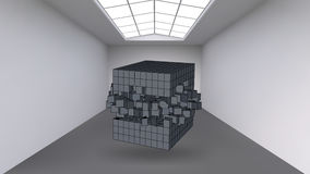 Hanging the cube from a multitude of small polygons in the large empty room. Exhibition space with abstract cubic shapes Royalty Free Stock Photography