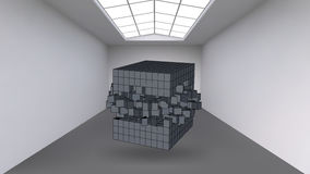 Hanging the cube from a multitude of small polygons in the large empty room. Exhibition space with abstract cubic shapes Stock Photo