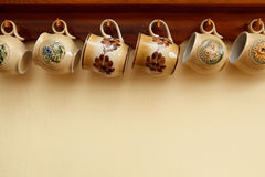 Hanging cups. Hanging ceramic cups in a row with some copyspace Royalty Free Stock Photo