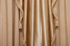 Hanging curtain. Hanging beige curtain Stock Image