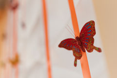 Hanging decor butterfly Stock Images