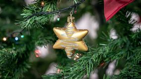 Hanging decoration ornement on a christmas tree. Closeup of a hanging decoration ornement on a christmas tree Stock Photo