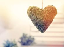 Hanging decorative heart. In a bright interior room stock photo