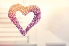 Hanging decorative heart. In a bright interior room royalty free stock photo