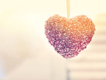 Hanging decorative heart. In a bright interior room royalty free stock photos