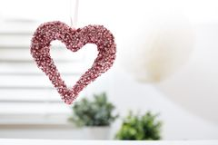 Hanging decorative heart. In a bright interior room stock images