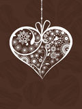 Hanging decorative heartshape on brown Royalty Free Stock Photo