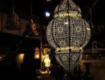 Hanging decorative lamp illuminating Stock Photography