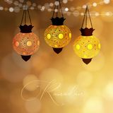 Hanging decorative lanterns glowing at night. Strings of bokeh lights. Greeting card, invitation for muslim holiday royalty free stock image