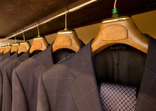 Hanging designer suits Stock Photos