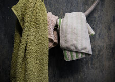 Hanging dirty towel and cotton on dirty toilet wall Stock Photos