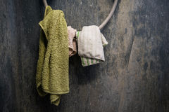 Hanging dirty towel and cotton on dirty toilet wall Stock Photography