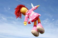 Hanging doll. Colorful doll hanging on the laundry wire against blue sky and drying Royalty Free Stock Photography