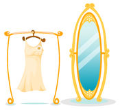 Hanging dress with large mirror Stock Photo