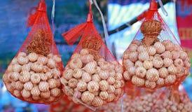 Hanging dried garlic in nylon net bag.  royalty free stock image