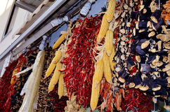 Hanging dried red peppers and corn Royalty Free Stock Images