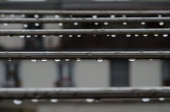 Hanging drops. Drops hanging from metal bars Stock Images