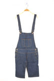 Hanging dungarees on white Stock Image