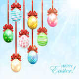 Hanging Easter eggs with bow Royalty Free Stock Photos