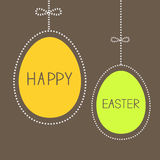 Hanging easter eggs with dash line and bow. Brown  Royalty Free Stock Image