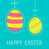 Hanging easter eggs with dash line and bow. Happy  Royalty Free Stock Images