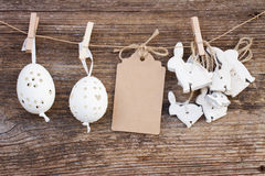 Hanging easter eggs and rabbits Royalty Free Stock Photos
