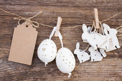Hanging easter eggs and rabbits Stock Photo