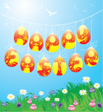 Hanging Easter eggs on spring blue sky Royalty Free Stock Photos