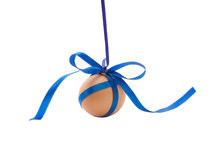 Hanging egg with blue ribbon and bow Royalty Free Stock Photos