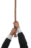 Hanging at end of rope. Man hanging at the end of his rope Stock Photography