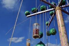 Hanging ethnic balls and bottles, carousel, pillar stock photo