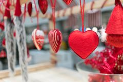 Hanging fabric heart ornaments on rope for Christmas decoration. Against blurred background. Selective focus royalty free stock image