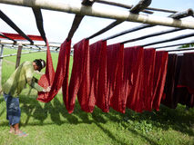 Hanging fabric. Worker was hanging fabric on a field in Sukoharjo, Central Java, Indonesia royalty free stock photo