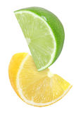 Hanging, falling, flying cutting piece of lemon and lime fruits isolated on white with clipping path Stock Photo