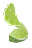 Hanging, falling and flying piece of lime fruits isolated Royalty Free Stock Photos