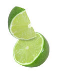 Hanging, falling and flying piece of lime fruits isolated Stock Photo