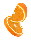 Hanging, falling and flying piece of orange fruits isolated Royalty Free Stock Images