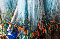 Hanging fishing nets. Hanging blue fishing nets with floats in Thailand Stock Image