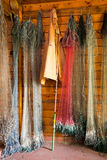 Hanging fishing nets, jacket and spinning rod Stock Photo