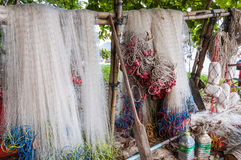 Hanging fishing nets. And fishing tackle near the beach in southern Thailand Stock Images