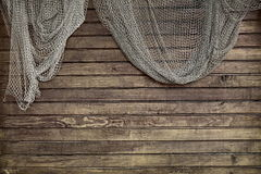 Hanging Fishnet on Rustic Wood Wall Stock Photography