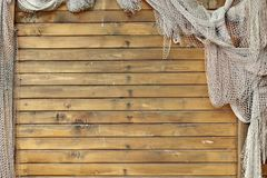 Hanging Fishnet on Wood Wall Royalty Free Stock Images