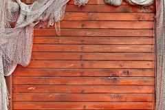 Hanging Fishnet on Wood Wall Royalty Free Stock Image