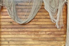 Hanging Fishnet on Wood Wall Stock Photography