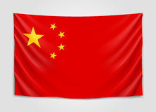 Hanging flag of China. People Republic of China. National flag concept. Stock Photo