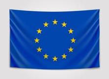 Hanging flag of Europe. European Union. European flag concept. royalty free illustration