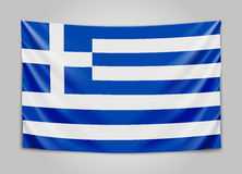 Hanging flag of Greece. Hellenic Republic. Greek national flag concept. Stock Photos