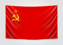 Hanging flag of USSR.Union of Soviet Socialist Republics. National flag concept. Stock Image